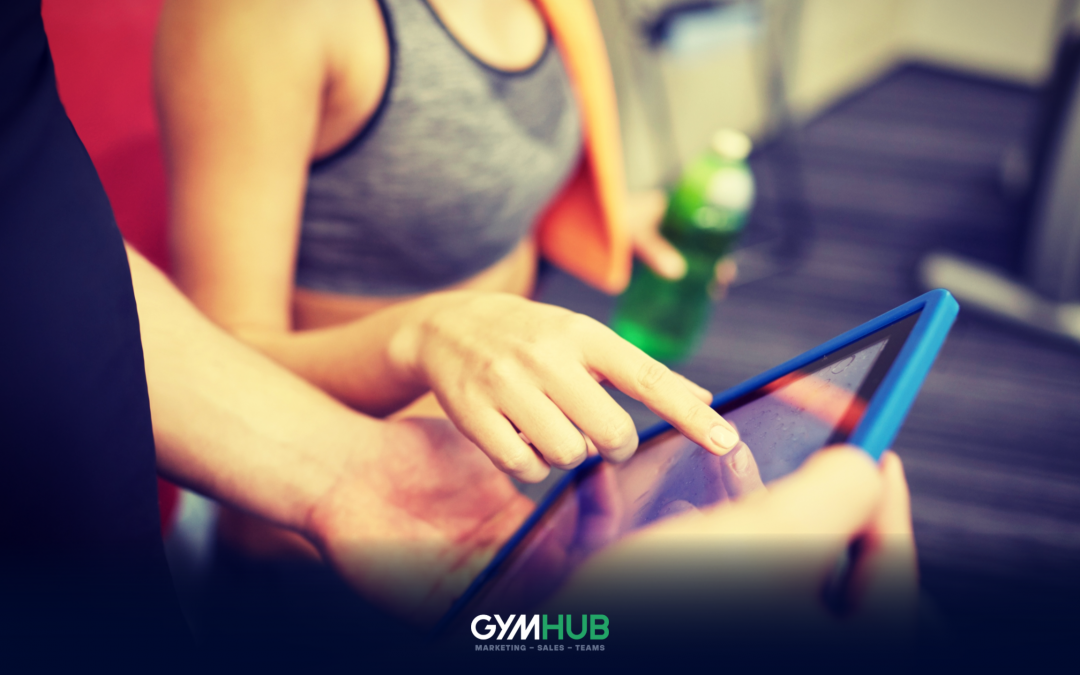 Gym Member Browsing Through a Tablet Computer