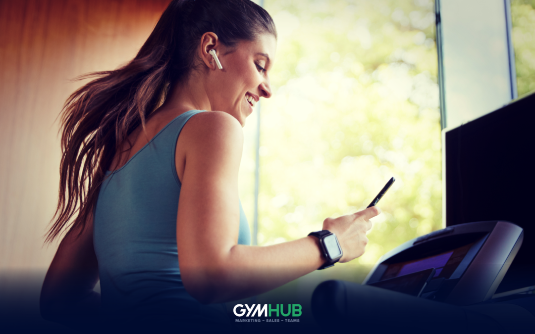 Gym Member on a Tread Mill Checking her Cellphone